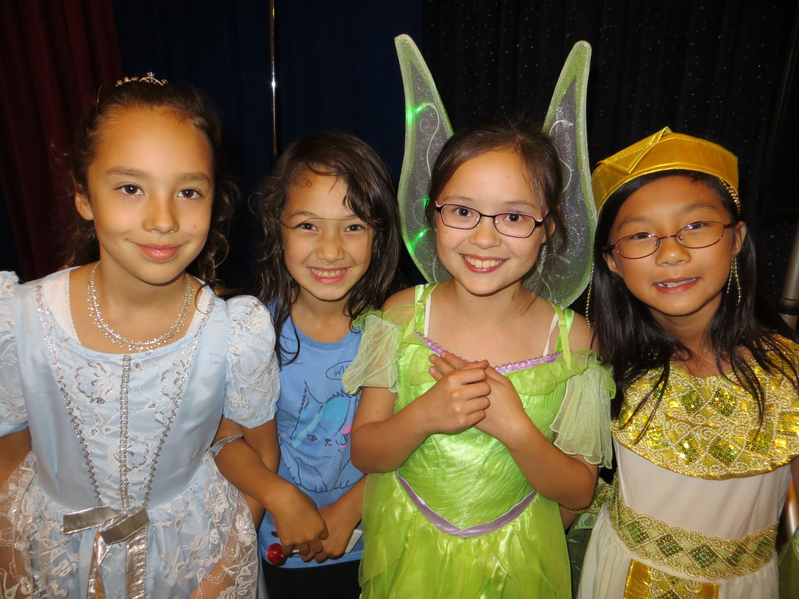 Four girls in fairy costumes