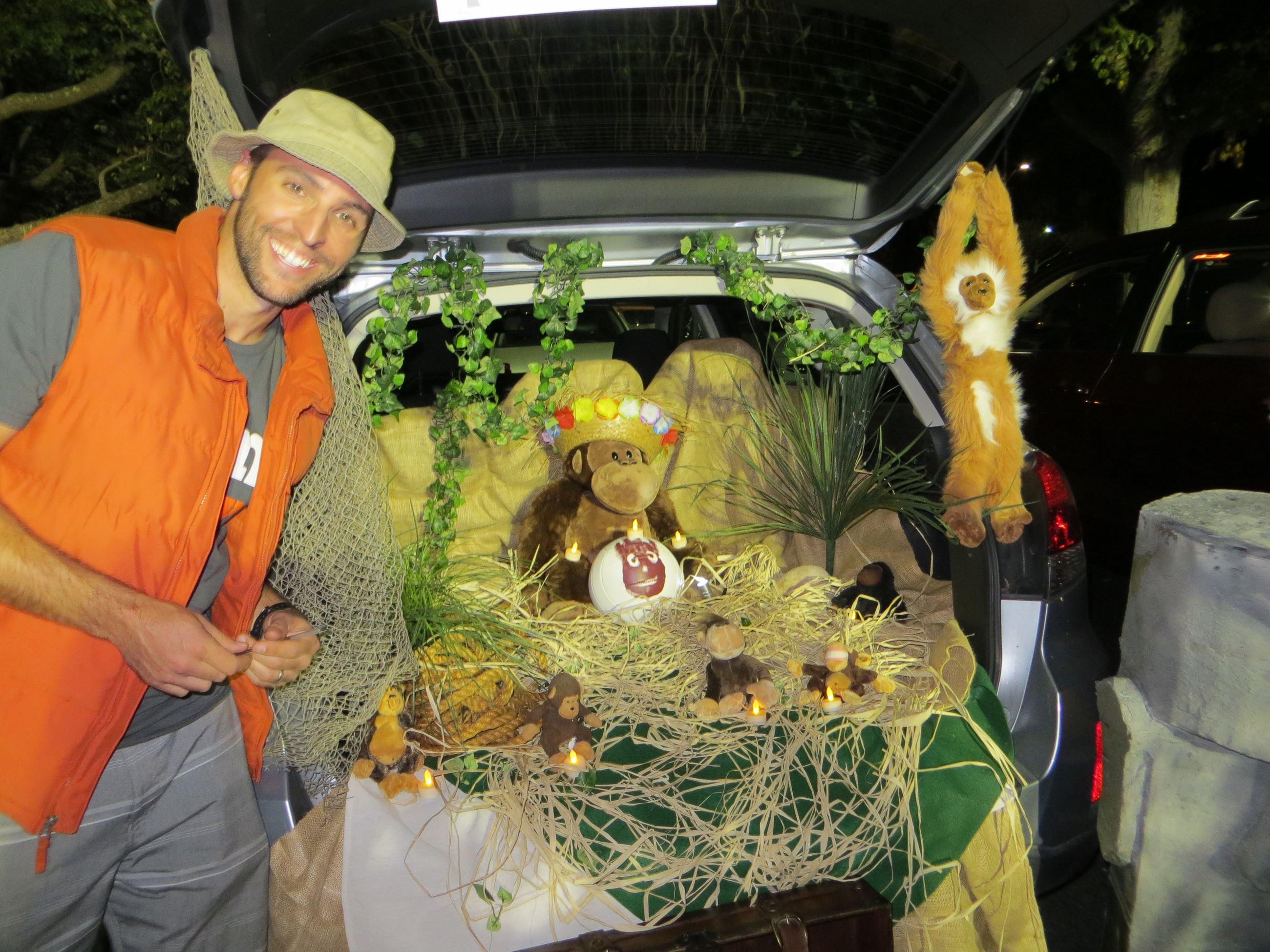 Man in safari costume with car truck decorated with Castaway movie decor