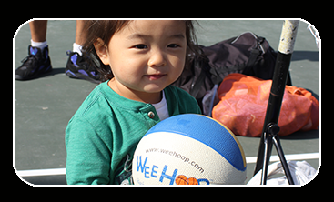 Little girl holding a small basketball