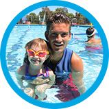 Preschooler With Swim Instructor