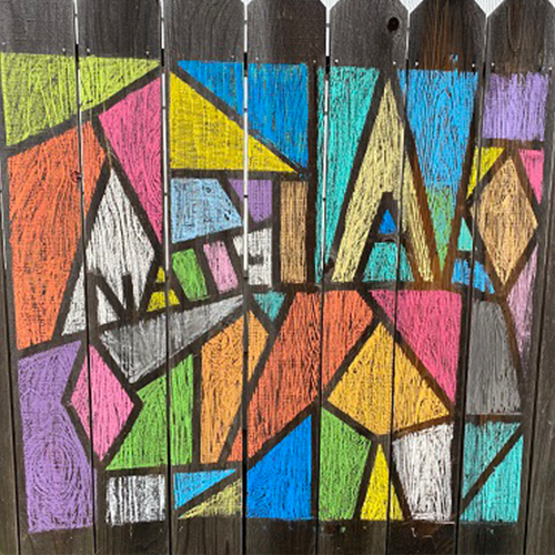 Stain Glass chalk art on a fence.