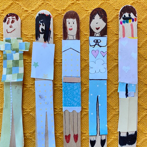 Popsicle stick bookmarks made to look like paper dolls.
