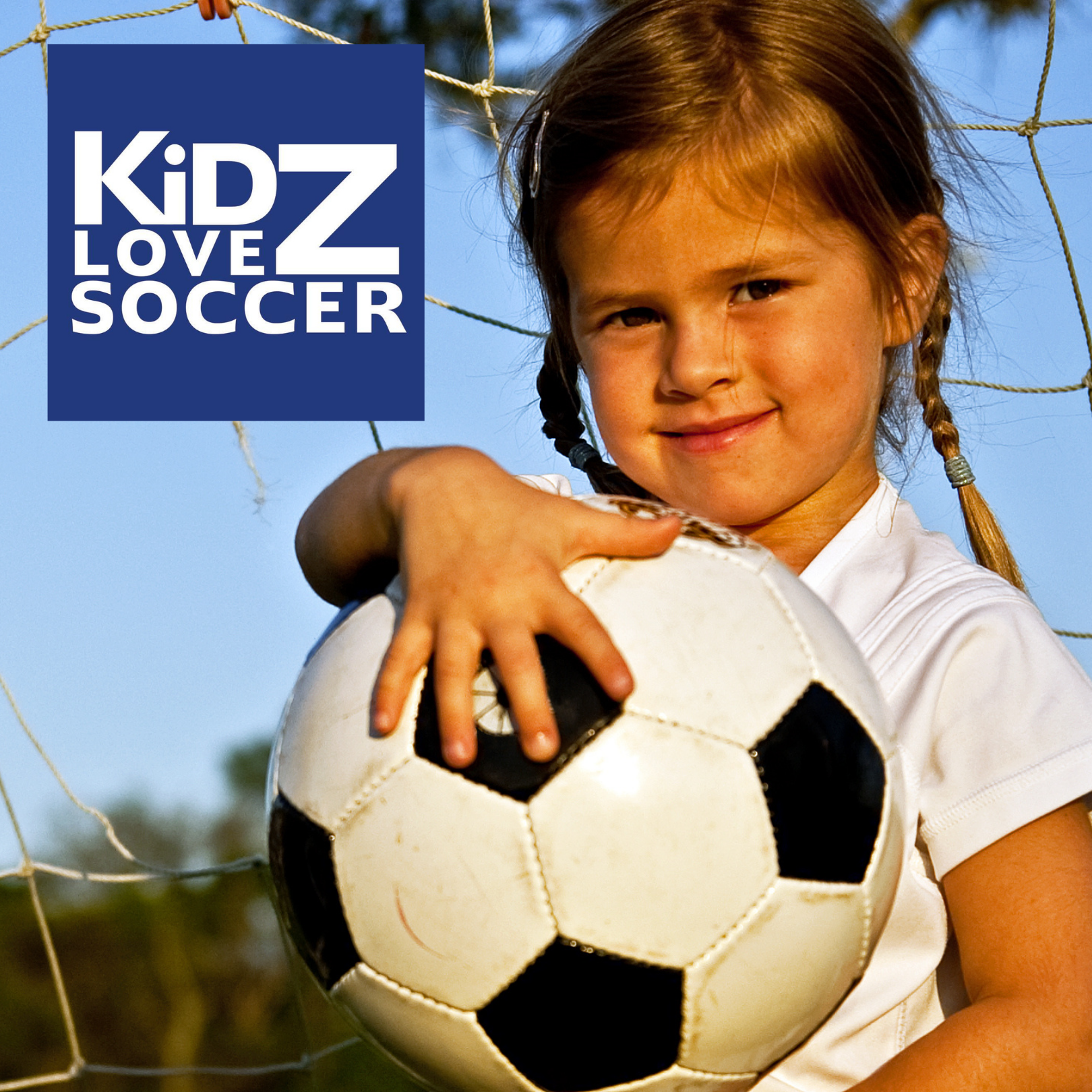 Girl holding soccer ball at net